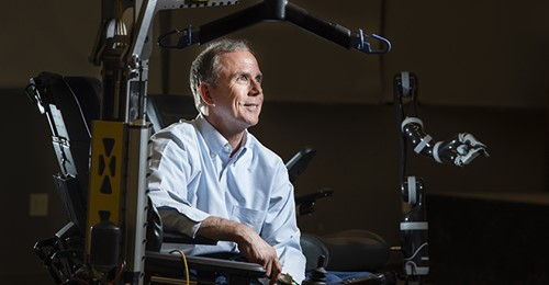 Dr. Rory Cooper seated in a robotic wheelchair